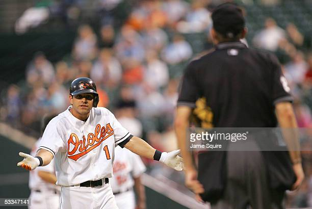 Brian Roberts of the Baltimore Orioles argues with home plate umpire Bill Hohn after being called out on strikes during the second inning of the game...