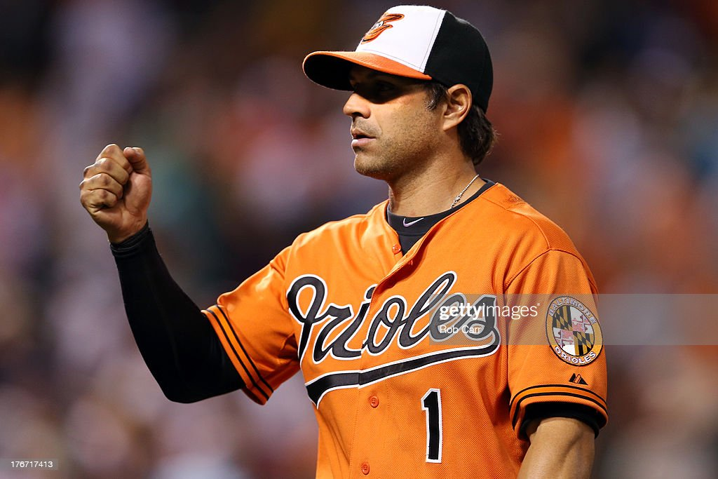 Brian Roberts #1 of the Baltimore Orioles celebrates following the Orioles 8-4 win over the Colorado Rockies at Oriole Park at Camden Yards on August 17, 2013 in Baltimore, Maryland.
