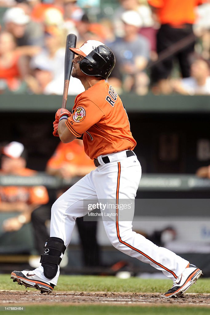 Brian Roberts #1 of the Baltimore Orioles takes a swing during a baseball game against the Cleveland Indians at Oriole Park at Camden Yards on June 30, 2012 in Baltimore, Maryland. The Indians won 11-5.