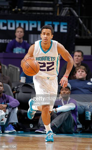 Brian Roberts of the Charlotte Hornets brings the ball up the court against the Toronto Raptors on March 6 2015 at Time Warner Cable Arena in...