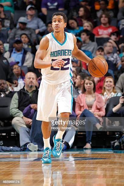Brian Roberts of the Charlotte Hornets brings the ball up the court against the Washington Wizards on March 9 2015 at Time Warner Cable Arena in...