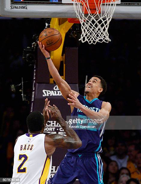 Brian Roberts of the Charlotte Hornets goes up for a layup against Brandon Bass of the Los Angeles Lakers during the second half of the basketball...