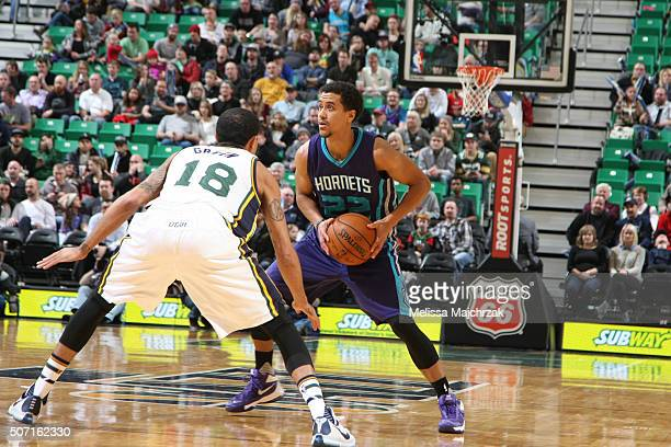 Brian Roberts of the Charlotte Hornets handles the ball against Erick Green of the Utah Jazz on January 27 2016 at vivintSmartHome Arena in Salt Lake...