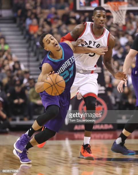 Brian Roberts of the Charlotte Hornets reacts to the defense of Delon Wright of the Toronto Raptors during NBA game action at Air Canada Centre on...