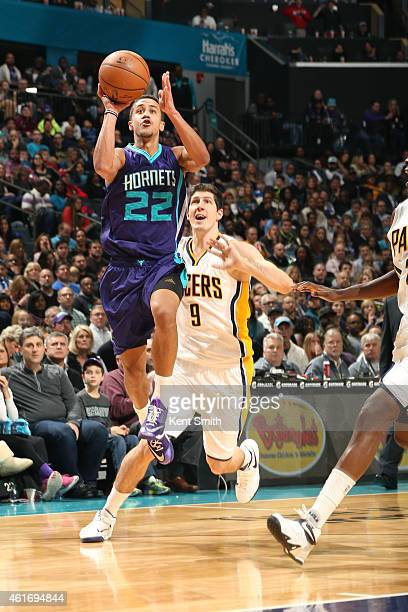 Brian Roberts of the Charlotte Hornets shoots against the Indiana Pacers during the game at the Time Warner Cable Arena on January 17 2015 in...