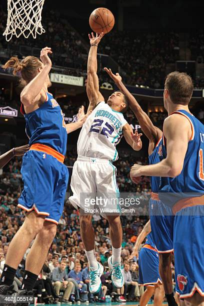 Brian Roberts of the Charlotte Hornets shoots against the New York Knicks during the game at the Time Warner Cable Arena on January 24 2015 in...