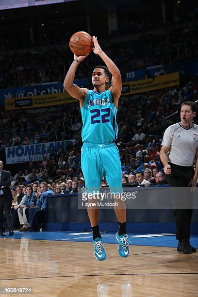 Brian Roberts of the Charlotte Hornets shoots against the Oklahoma City Thunderduring the game on December 26 2014 at Chesapeake Energy Arena in...