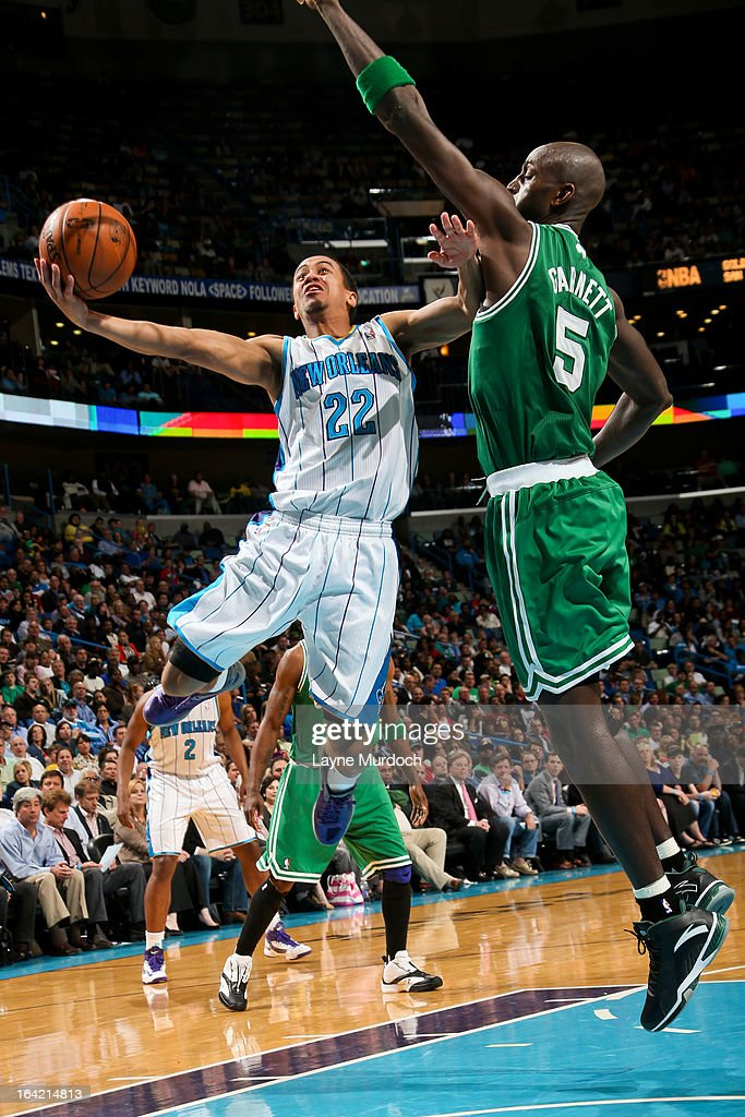 Brian Roberts #22 of the New Orleans Hornets attempts a layup against <a gi-track='captionPersonalityLinkClicked' href=/galleries/search?phrase=Kevin+Garnett&family=editorial&specificpeople=201473 ng-click='$event.stopPropagation()'>Kevin Garnett</a> #5 of the Boston Celtics on March 20, 2013 at the New Orleans Arena in New Orleans, Louisiana.