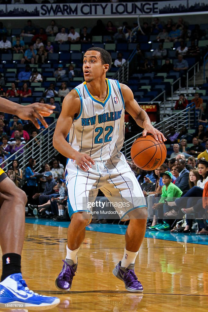 Brian Roberts #22 of the New Orleans Hornets controls the ball against the Golden State Warriors on March 18, 2013 at the New Orleans Arena in New Orleans, Louisiana.