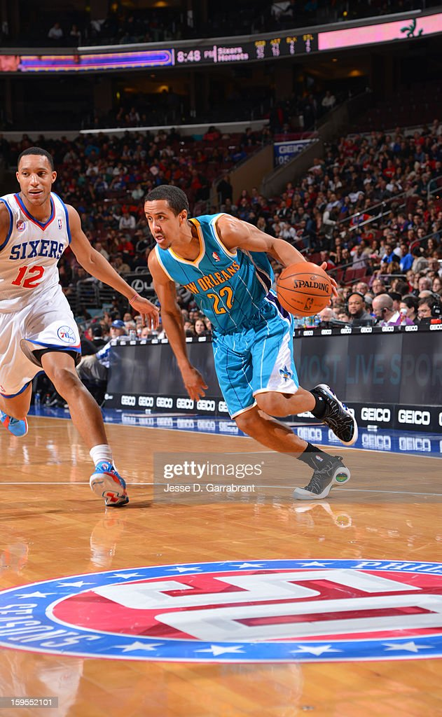 Brian Roberts #22 of the New Orleans Hornets dribbles to the basket against Evan Turner #12 of the Philadelphia 76ers during the game at the Wells Fargo Center on January 15, 2013 in Philadelphia, Pennsylvania.