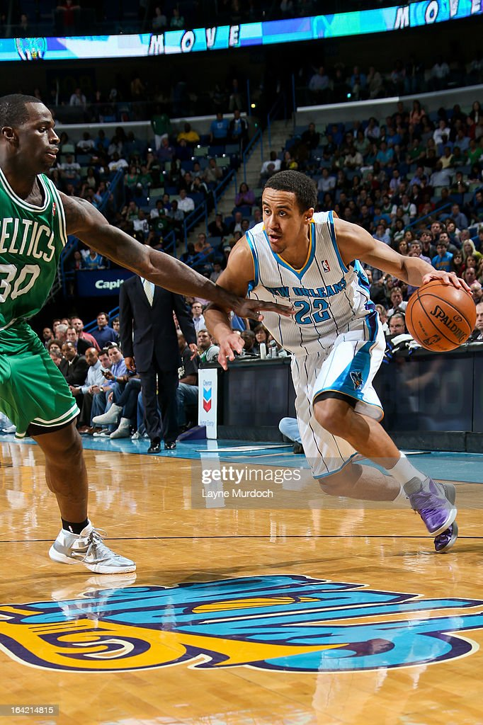 Brian Roberts #22 of the New Orleans Hornets drives against <a gi-track='captionPersonalityLinkClicked' href=/galleries/search?phrase=Brandon+Bass&family=editorial&specificpeople=233806 ng-click='$event.stopPropagation()'>Brandon Bass</a> #30 of the Boston Celtics on March 20, 2013 at the New Orleans Arena in New Orleans, Louisiana.