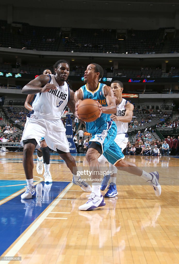 Brian Roberts #22 of the New Orleans Hornets drives against <a gi-track='captionPersonalityLinkClicked' href=/galleries/search?phrase=Jae+Crowder&family=editorial&specificpeople=7357507 ng-click='$event.stopPropagation()'>Jae Crowder</a> #9 of the Dallas Mavericks during the game between the New Orleans Hornets and the Dallas Mavericks on October 22, 2012 at the American Airlines Center in Dallas, Texas.