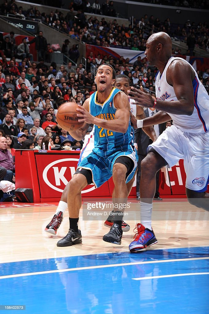 Brian Roberts #22 of the New Orleans Hornets drives against <a gi-track='captionPersonalityLinkClicked' href=/galleries/search?phrase=Lamar+Odom&family=editorial&specificpeople=201519 ng-click='$event.stopPropagation()'>Lamar Odom</a> #7 of the Los Angeles Clippers at Staples Center on November 26, 2012 in Los Angeles, California.