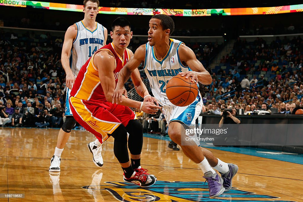 Brian Roberts #22 of the New Orleans Hornets drives the ball around <a gi-track='captionPersonalityLinkClicked' href=/galleries/search?phrase=Jeremy+Lin&family=editorial&specificpeople=6669516 ng-click='$event.stopPropagation()'>Jeremy Lin</a> #7 of the Houston Rockets at New Orleans Arena on January 9, 2013 in New Orleans, Louisiana.