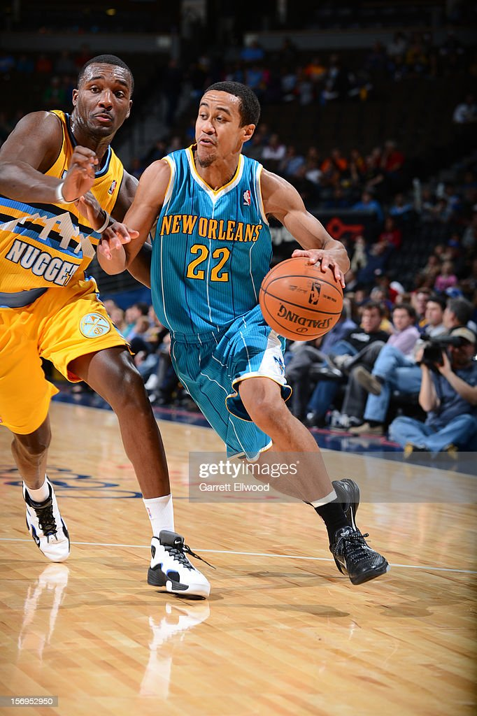 Brian Roberts #22 of the New Orleans Hornets drives under pressure during the game between the New Orleans Hornets and the Denver Nuggets on November 25, 2012 at the Pepsi Center in Denver, Colorado.