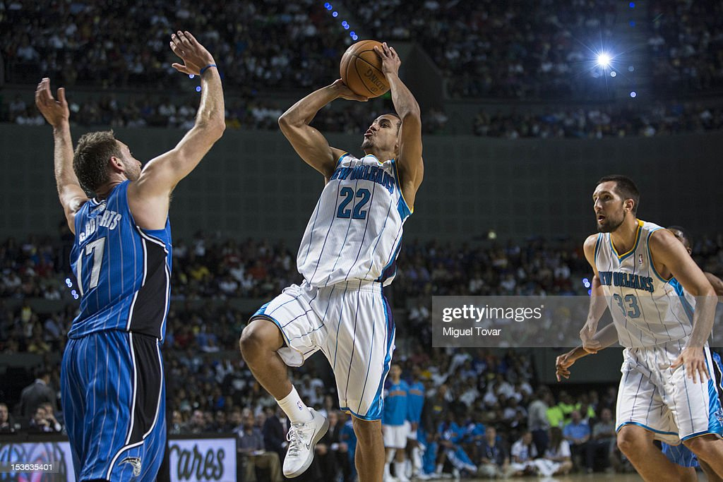 Brian Roberts #22 of the New Orleans Hornets goes to the basket as <a gi-track='captionPersonalityLinkClicked' href=/galleries/search?phrase=Josh+McRoberts+-+Basketball+Player&family=editorial&specificpeople=732530 ng-click='$event.stopPropagation()'>Josh McRoberts</a> #17 of the Orlando Magic defends during the game between the Orlando Magic and the New Orleans Hornets on October 7, 2012 at Mexico City Arena in Mexico City.