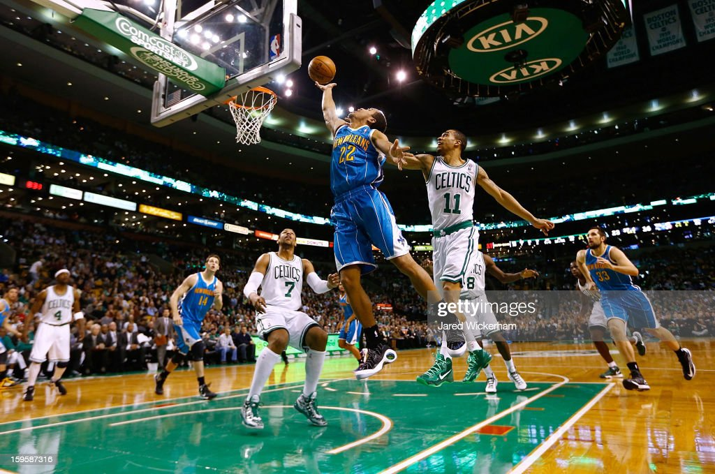 Brian Roberts #22 of the New Orleans Hornets goes up for a layup in front of <a gi-track='captionPersonalityLinkClicked' href=/galleries/search?phrase=Courtney+Lee&family=editorial&specificpeople=730223 ng-click='$event.stopPropagation()'>Courtney Lee</a> #11 of the Boston Celtics during the game on January 16, 2013 at TD Garden in Boston, Massachusetts.