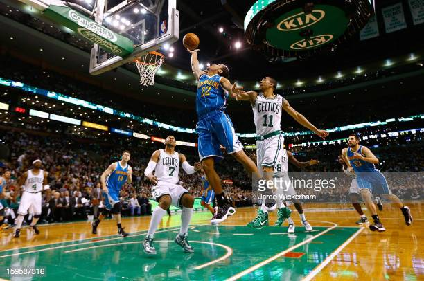 Brian Roberts of the New Orleans Hornets goes up for a layup in front of Courtney Lee of the Boston Celtics during the game on January 16 2013 at TD...