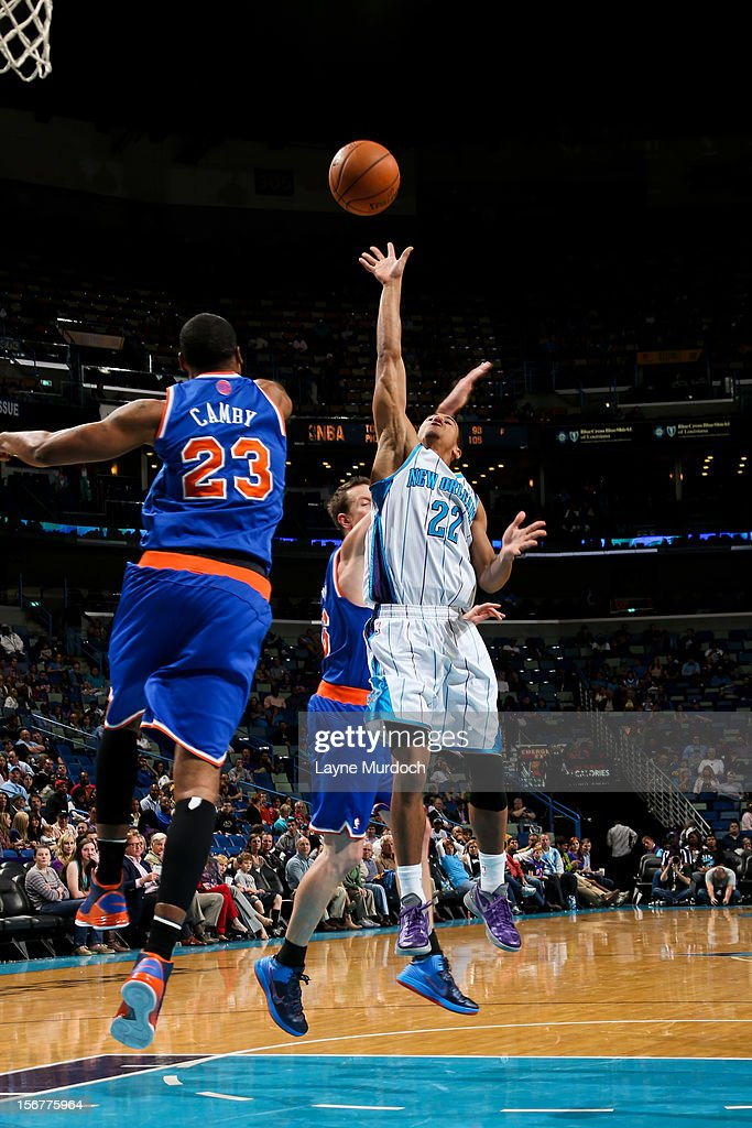 Brian Roberts #22 of the New Orleans Hornets shoots a floater against <a gi-track='captionPersonalityLinkClicked' href=/galleries/search?phrase=Steve+Novak&family=editorial&specificpeople=693015 ng-click='$event.stopPropagation()'>Steve Novak</a> #16 and <a gi-track='captionPersonalityLinkClicked' href=/galleries/search?phrase=Marcus+Camby&family=editorial&specificpeople=201722 ng-click='$event.stopPropagation()'>Marcus Camby</a> #23 of the New York Knicks on November 20, 2012 at the New Orleans Arena in New Orleans, Louisiana.