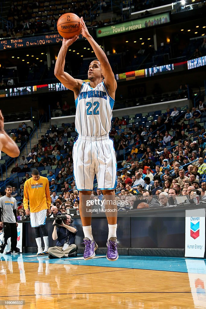 Brian Roberts #22 of the New Orleans Hornets shoots a three-pointer against the San Antonio Spurs on January 7, 2013 at the New Orleans Arena in New Orleans, Louisiana.