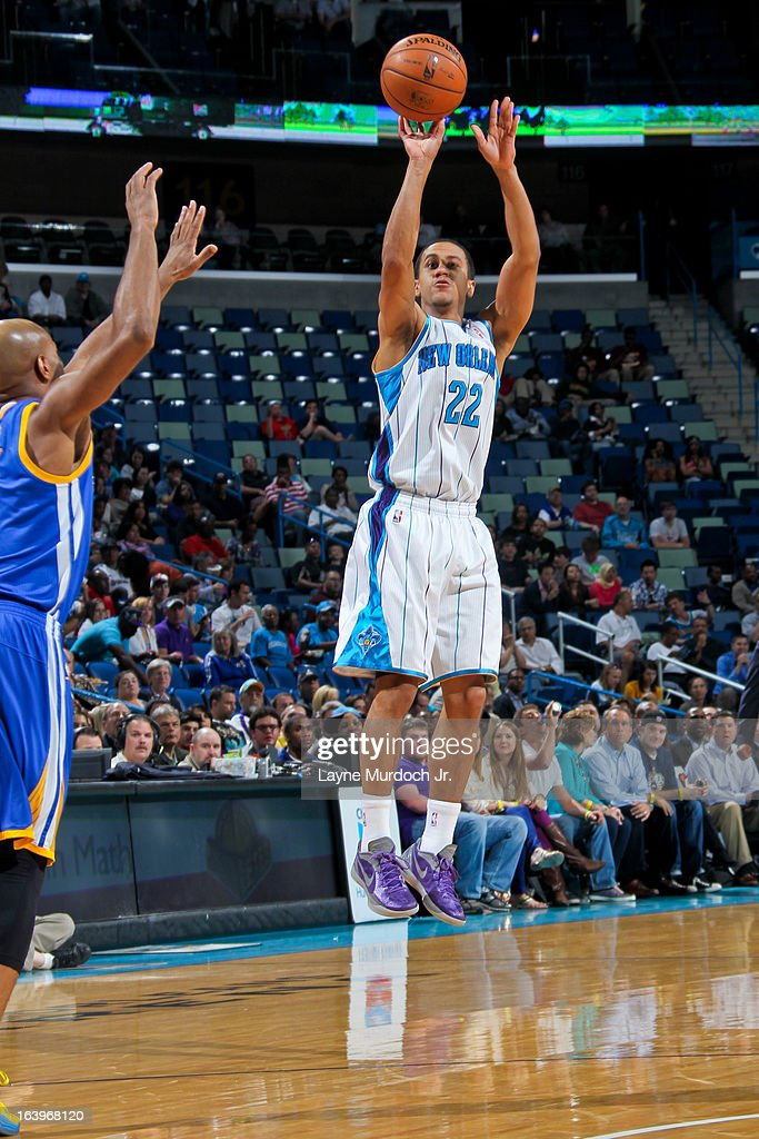 Brian Roberts #22 of the New Orleans Hornets shoots a three-pointer against the Golden State Warriors on March 18, 2013 at the New Orleans Arena in New Orleans, Louisiana.