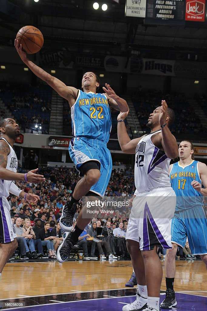 Brian Roberts #22 of the New Orleans Hornets takes the ball to the basket against Chuck Hayes #42 of the Sacramento Kings on April 10, 2013 at Sleep Train Arena in Sacramento, California.