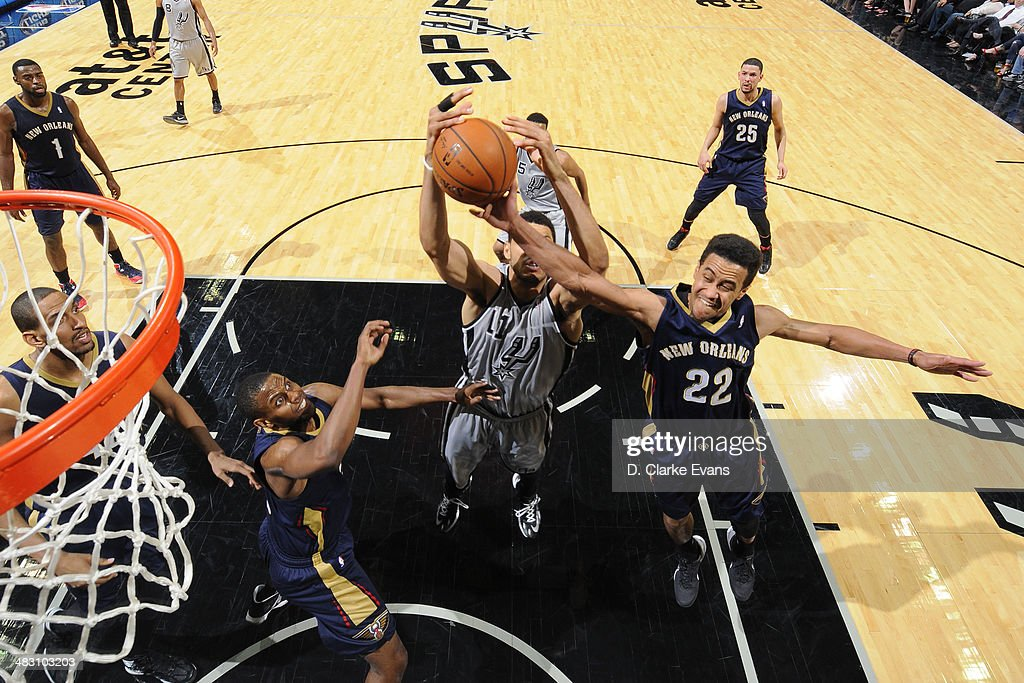 Brian Roberts #22 of the New Orleans Pelicans grabs a rebound against the San Antonio Spurs at the AT&T Center on March 29, 2014 in San Antonio, Texas.