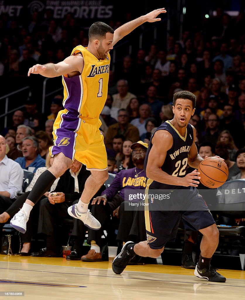 Brian Roberts #22 of the New Orleans Pelicans puts move on Jordan Farmar #1 of the Los Angeles Lakers at Staples Center on November 12, 2013 in Los Angeles, California.