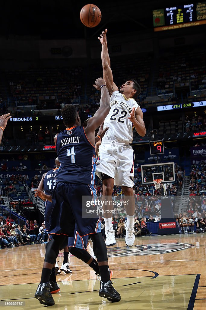 Brian Roberts #22 of the New Orleans Pelicans shoots against <a gi-track='captionPersonalityLinkClicked' href=/galleries/search?phrase=Jeff+Adrien&family=editorial&specificpeople=727235 ng-click='$event.stopPropagation()'>Jeff Adrien</a> #4 of the Charlotte Bobcats on November 2, 2013 at the New Orleans Arena in New Orleans, Louisiana.