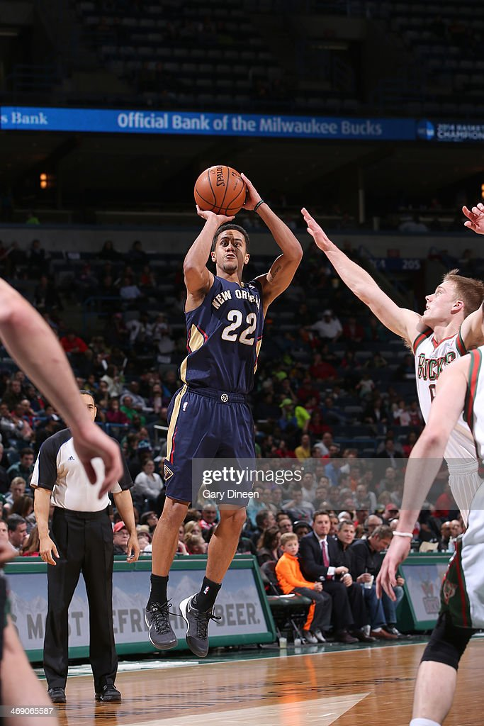Brian Roberts #22 of the New Orleans Pelicans shoots against Nate Wolters #6 of the Milwaukee Bucks on February 12, 2014 at the BMO Harris Bradley Center in Milwaukee, Wisconsin.