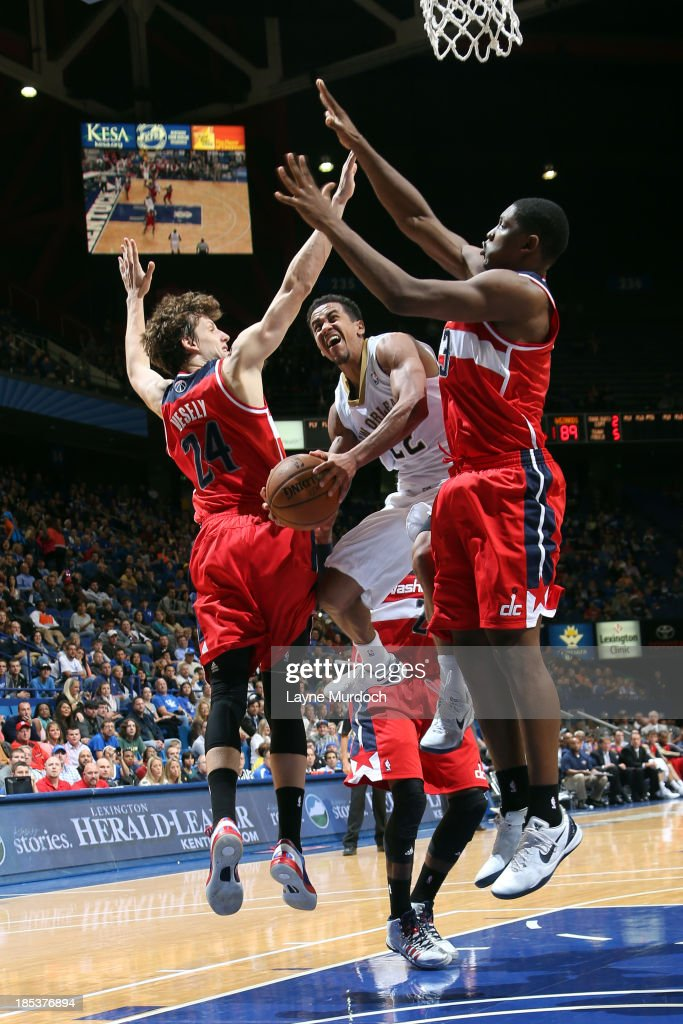 Brian Roberts #22 of the New Orleans Pelicans shoots between <a gi-track='captionPersonalityLinkClicked' href=/galleries/search?phrase=Jan+Vesely&family=editorial&specificpeople=5620499 ng-click='$event.stopPropagation()'>Jan Vesely</a> #24 and <a gi-track='captionPersonalityLinkClicked' href=/galleries/search?phrase=Kevin+Seraphin&family=editorial&specificpeople=6474998 ng-click='$event.stopPropagation()'>Kevin Seraphin</a> #13 of the Washington Wizards during an NBA game on October 19, 2013 at Rupp Arena in Lexington, Kentucky.
