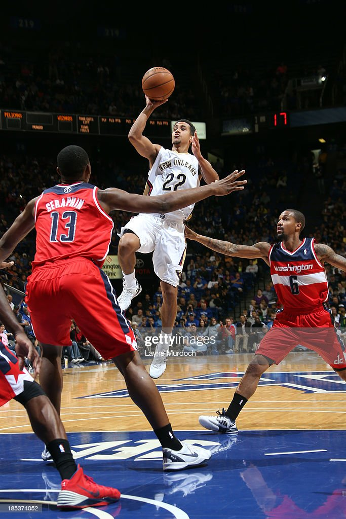 Brian Roberts #22 of the New Orleans Pelicans shoots over <a gi-track='captionPersonalityLinkClicked' href=/galleries/search?phrase=Kevin+Seraphin&family=editorial&specificpeople=6474998 ng-click='$event.stopPropagation()'>Kevin Seraphin</a> #13 and <a gi-track='captionPersonalityLinkClicked' href=/galleries/search?phrase=Eric+Maynor&family=editorial&specificpeople=4194194 ng-click='$event.stopPropagation()'>Eric Maynor</a> #6 of the Washington Wizards during an NBA game on October 19, 2013 at Rupp Arena in Lexington, Kentucky.