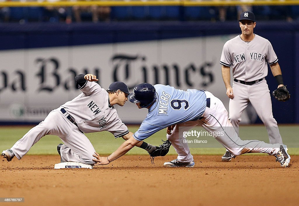 Brian Roberts #14 of the New York Yankees catches <a gi-track='captionPersonalityLinkClicked' href=/galleries/search?phrase=Wil+Myers&family=editorial&specificpeople=7562808 ng-click='$event.stopPropagation()'>Wil Myers</a> #9 of the Tampa Bay Rays attempting to steal second base during the 11th inning of a game on April 20, 2014 at Tropicana Field in St. Petersburg, Florida.