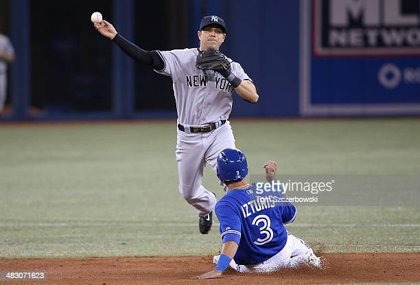 Brian Roberts of the New York Yankees gets the force out at second base but cannot turn the double play in the first inning during MLB game action as...