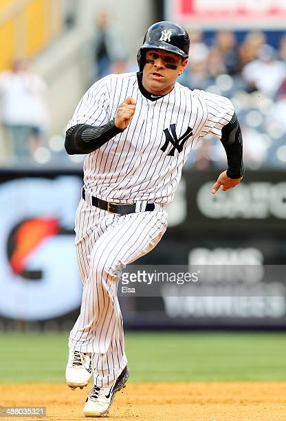 Brian Roberts of the New York Yankees scores on a hit from teammate Ichiro Suzuki in the eighth inning against the Tampa Bay Rays on May 3 2014 at...