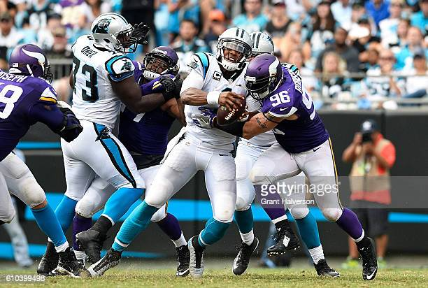 Brian Robison of the Minnesota Vikings sacks Cam Newton of the Carolina Panthers in the 2nd half during the game at Bank of America Stadium on...
