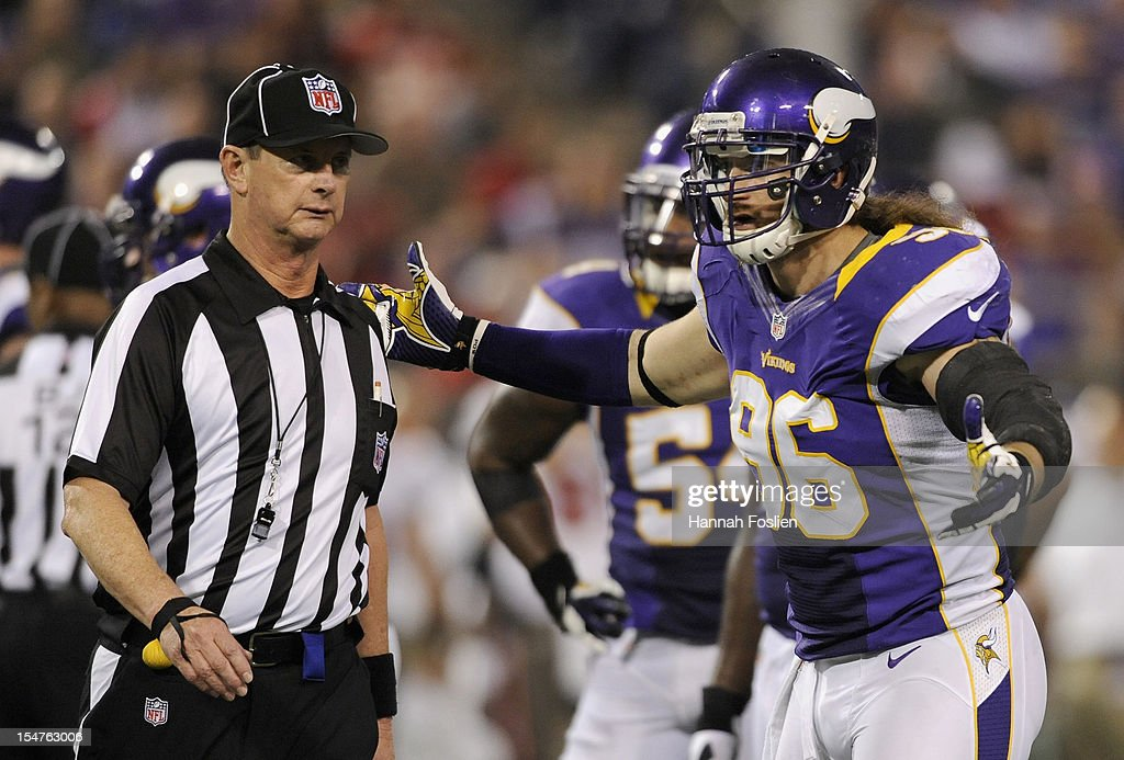 Brian Robison #96 of the Minnesota Vikings speaks with field judge Jim Howey #37 after an altercation between Jared Allen #69 and Donald Penn #70 of the Tampa Bay Buccaneers during the third quarter of the game on October 25, 2012 at Mall of America Field at the Hubert H. Humphrey Metrodome in Minneapolis, Minnesota.