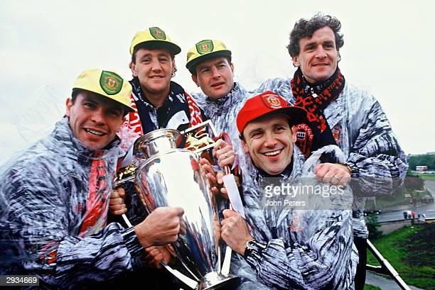 Brian Robson Steve Bruce Denis Irwin Mickey Phelan and Mark Hughes of Manchester United celebrate with the FA Premiership Trophy during the parade to...