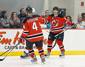 Brian Rolston and Scott Stevens of the New Jersey Devils Red Team celebrate a goal against the New Jersey Devils White Team during the 1995 Stanley...