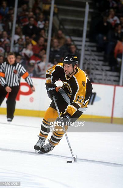 Brian Rolston of the Boston Bruins skates with the puck during an NHL game against the New Jersey Devils on April 6 2001 at the Continental Airlines...