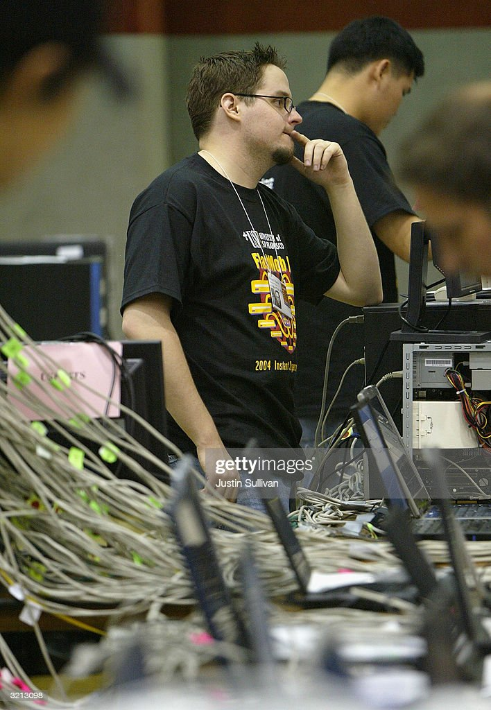 Brian Sabin of San Francisco works on setting up a computer for Flashmob 1, the first flashmob supercomputer April 3, 2004 at the University of San Francisco in San Francisco, California. Hundreds of computer enthusiasts connected hundreds of computers via high-speed LAN to work together as a single supercomputer in hopes to place in the top 500 fastest supercomputers on earth.