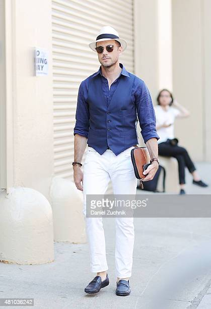 Brian Sacawa is seen outside the Ricardo Seco show wearing a custom waistcoat Vilebrequin shirt J Crew jeans Tod's loafers Goorin Brothers hat and...