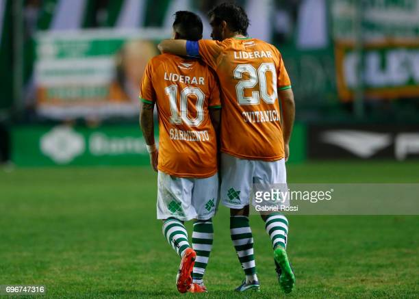Brian Sarmiento of Banfield celebrates with teammate Dario Cvitanich after scoring the second goal of his team during a match between Banfield and...