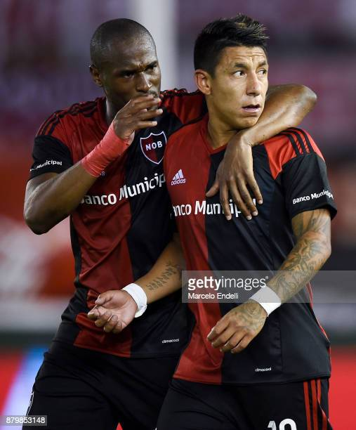 Brian Sarmiento of Newell's Old Boys celebrates with teammate Luis Leal after scoring the second goal of his team during a match between River and...