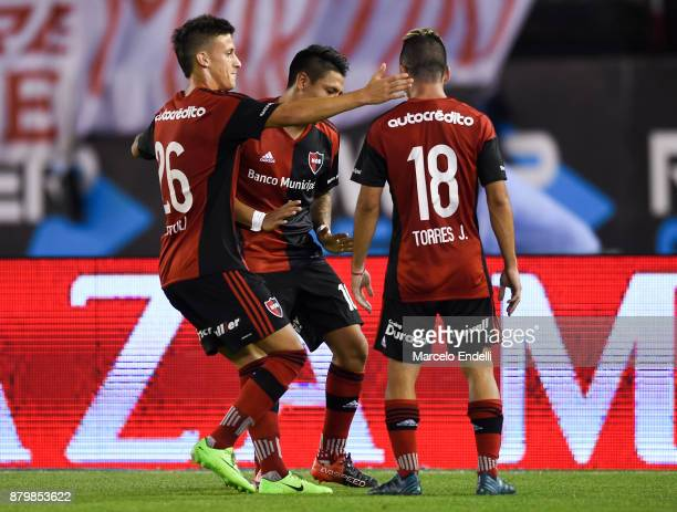 Brian Sarmiento of Newell's Old Boys celebrates with teammates after scoring the second goal of his team during a match between River and Newell's...