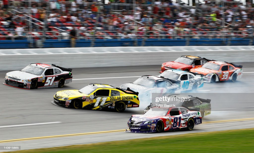 Brian Scott, driver of the #11 Dollar General Toyota, <a gi-track='captionPersonalityLinkClicked' href=/galleries/search?phrase=Kurt+Busch&family=editorial&specificpeople=201728 ng-click='$event.stopPropagation()'>Kurt Busch</a>, driver of the #1 Phoenix Construction Services Chevrolet, Jason Bowles, driver of the #81 American Majority Toyota, <a gi-track='captionPersonalityLinkClicked' href=/galleries/search?phrase=Erik+Darnell&family=editorial&specificpeople=574945 ng-click='$event.stopPropagation()'>Erik Darnell</a>, driver of the #40 Curtis Key Plumbing Chevrolet, and T.J. Bell, driver of the #50 MAKE Motorsports Chevrolet, are involved in an on track incident during the NASCAR Nationwide Series Aaron's 312 at Talladega Superspeedway on May 5, 2012 in Talladega, Alabama.