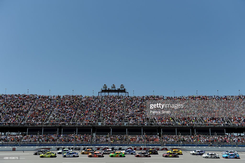 Brian Scott, driver of the #33 Shore Lodge Chevrolet, and Paul Menard, driver of the #27 Richmond / Menard's Chevrolet, lead the field to the start of the NASCAR Sprint Cup Series Aaron's 499 at Talladega Superspeedway on May 4, 2014 in Talladega, Alabama.