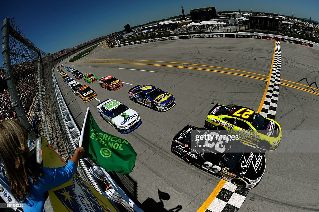 Brian Scott, driver of the #33 Shore Lodge Chevrolet, and Paul Menard, driver of the #27 Richmond / Menard's Chevrolet, lead the field to start the NASCAR Sprint Cup Series Aaron's 499 at Talladega Superspeedway on May 4, 2014 in Talladega, Alabama.