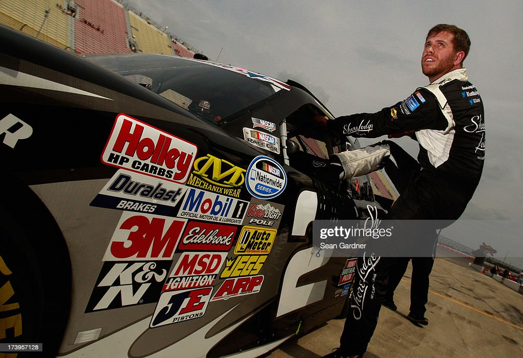 Brian Scott, driver of the #2 Shore Lodge Chevrolet, gets into his car during qualifying for the NASCAR Nationwide Series Alliance Truck Parts 250 at Michigan International Speedway on June 15, 2013 in Brooklyn, Michigan.