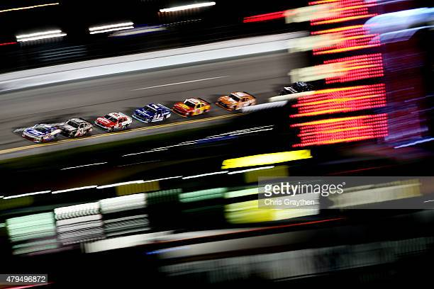 Brian Scott driver of the Shore Lodge Chevrolet leads a pack of cars during the NASCAR XFINITY Series Subway Firecracker 250 Powered By CocaCola at...
